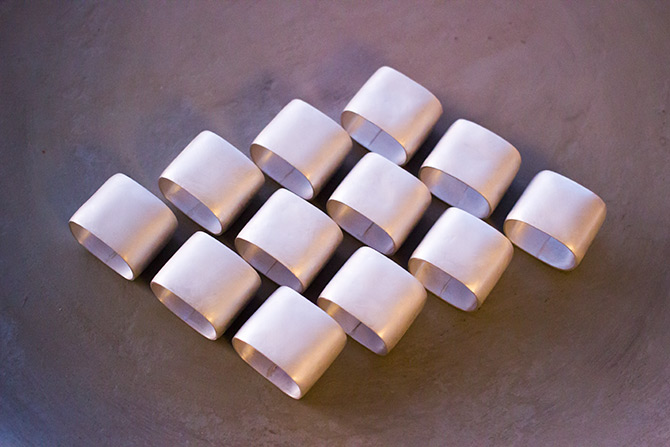 A set of 12 fine silver napkin rings