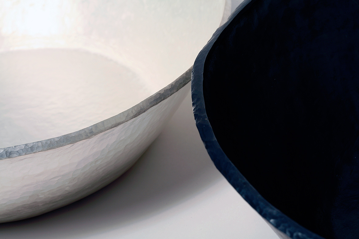 A set of two vessels in patinated fine silver and vitreous enamel