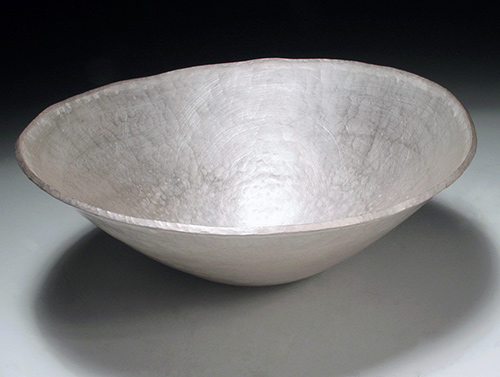 A forged fine silver bowl